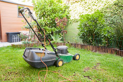 Lawn Mower. Image of a lawn mower in a household garden cutting grass Stock Images