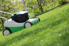 Lawn mower on the lawn Stock Images