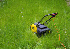 Lawn Mower in long grass Stock Images