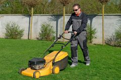 Lawn mower man working Royalty Free Stock Photography