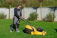Lawn mower man working Stock Photos