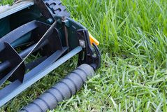 Lawn Mower. A lawn mover in the middle of mowing a lawn Royalty Free Stock Photography