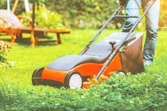 Lawn mower mower grass equipment mowing gardener care work tool.  royalty free stock image