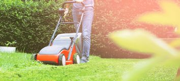 Lawn mower mower grass equipment mowing gardener care work tool.  royalty free stock photography