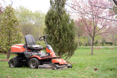 Lawn mower in the park in the spring Royalty Free Stock Photography