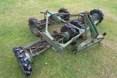 Lawn mower tractor grass cutting agriculture machinery green tyre wheels assembly. Uk stock images