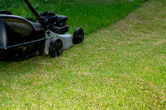 Lawn mower at work Stock Images