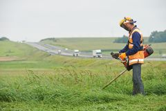 Lawn mower worker Stock Photos
