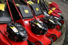 Lawn-mowers. In a row royalty free stock photos