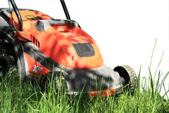 Lawn mowers. Electric lawn mower, which is exactly cut the grass on your lawn Stock Photos