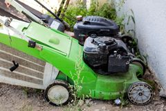 Lawn mower on a lawn on a background of trees royalty free stock images