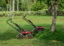 Lawn mowers at the park royalty free stock photos