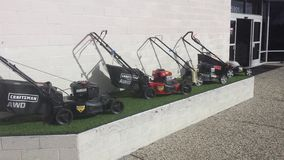 Lawn mowers. Variety market group Royalty Free Stock Photos