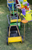 Lawn mowers and watering cans. On display and sale Stock Images