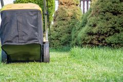 Lawn mowing / mowing the lawn Stock Photo