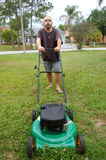 LAWN MOWING man stock photography