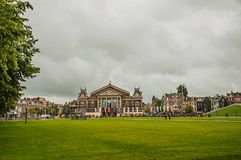 Lawn of Museumplein Museum Square in front of the Concertgebouw Concert Hall in Amsterdam. Amsterdam, Netherlands - June 24, 2017. Lawn of Museumplein Museum Stock Photo