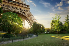 Lawn near Eiffel Tower. Green lawn near Eiffel Tower in Paris at sunrise, France Stock Images