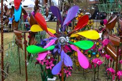Lawn ornament whirl-a-gig for sale at spring garden show on windy day in Tulsa Oklahoma USA 4 13 2018 stock photography