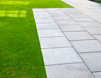 Lawn and pavers royalty free stock images