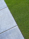 Lawn and Paving. Paving and grass in triangular form stock image
