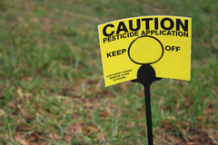 Lawn Pesticide Sign. Warning for pets, humans and other living things off the lawn after pesticide control application Stock Photography
