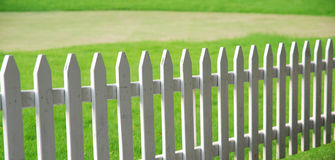Lawn and railing. The white railing protecting the green lawn Royalty Free Stock Image