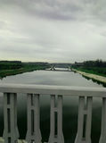 Lawn rain sky bridge river Royalty Free Stock Image