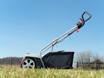 Lawn scarifier. Shot on backyard lawn over the sky Stock Image