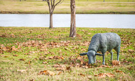 Lawn Sculpture of a Grazing Sheep Royalty Free Stock Image
