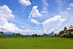 Lawn with the sky and cloud Stock Images