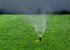 Lawn with Sprinkler Royalty Free Stock Photos