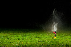 Lawn sprinkler at night Stock Photography