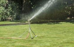 Lawn sprinkler Stock Photos