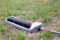 Lawn sprinkler spaying water Stock Images