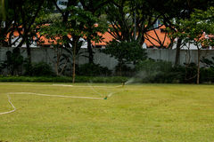 Lawn sprinkler spaying water Royalty Free Stock Image
