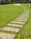 Lawn stone path Stock Photos