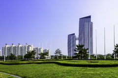 lawn and tall buildings stock photography