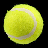 Lawn Tennis Ball Isolated on Black Background. A bright green lawn tennis ball isolated on a black background Royalty Free Stock Images