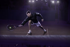 Lawn tennis player in action Stock Images