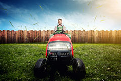 Lawn Tractor. Man on a Lawn Tractor Royalty Free Stock Image