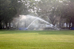Lawn watering in the Park. Stock Images