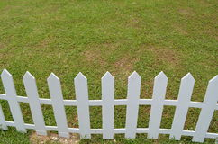 Lawn with white fence Royalty Free Stock Photo
