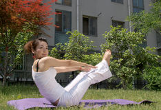 The lawn of yoga. Pretty girl in the outdoor lawn doing yoga. Photos in May 19, 2012 shooting Royalty Free Stock Photography