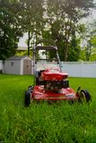 Lawnmower. Waiting to cut the grass in the backyard royalty free stock photo