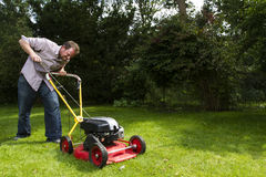 Lawnmower. Man trying to start a lawnmower Stock Images