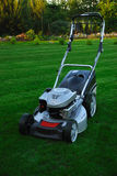 A lawnmower. Standing on a lawn Royalty Free Stock Images