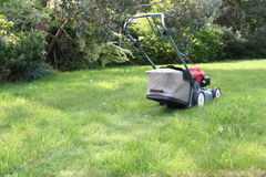 Lawnmower. In the garden Royalty Free Stock Photo