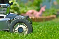 Lawnmower in the back yard Stock Photo