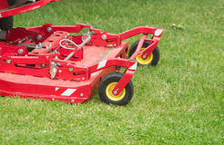 Lawnmower cuts a green lawn Stock Images